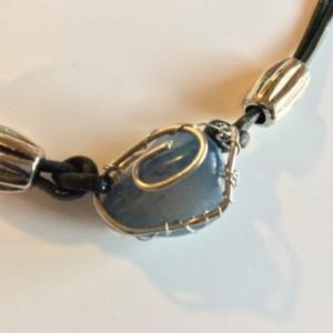 Wire wrapped polished stone leather bracelet, dark blue stone