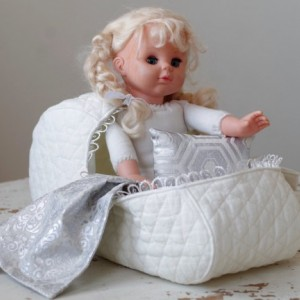 Pattern #1 Doll bassinet carrier of quilted cotton with a pillow and a blanket