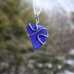 Navy (deep) blue sea glass with a wire heart on a white hemp cord