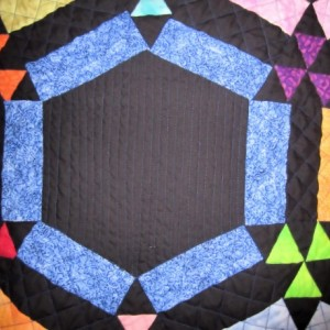 Amish Double Wedding Ring Quilt with Black Background Appraised