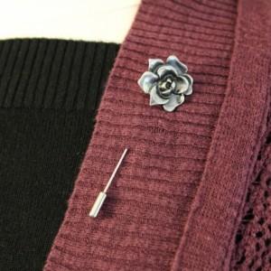 Silver rose sweater pin