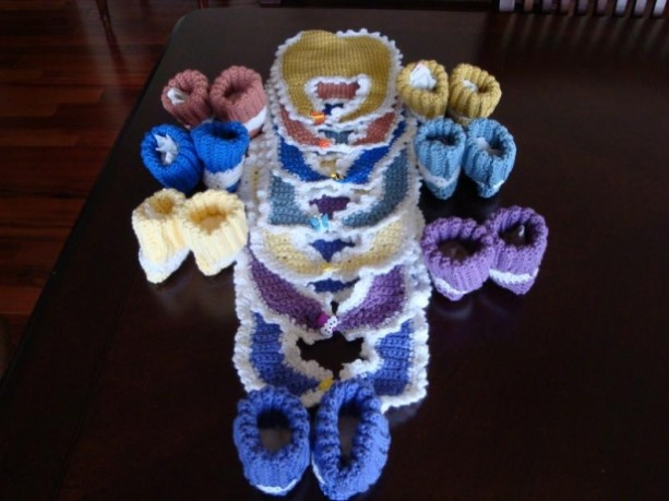 A complete seven day set of booties and bibs. One for each day of the week.