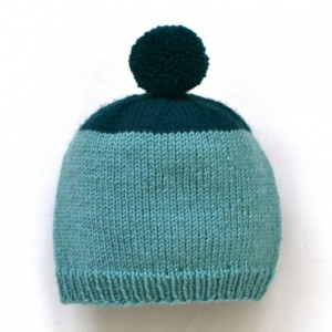 Hand knit wool newborn hat -- knitted baby beanie with pompom