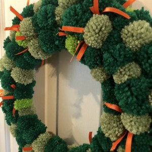 Green Yarn and Orange Ribbon St Patricks Day Pom Pom Wreath