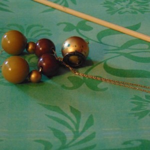 Gold Snake Chain Green Gold Brown Resin Bead Golden Focal Bead has Turquoise Flecks Tarnished Gold Etched Ring Golden Tassel Necklace