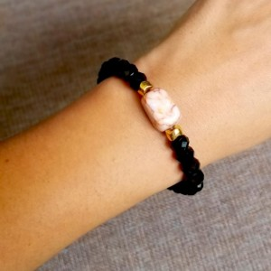 Black Beaded Bracelet with a touch of gold and a pink marble square bead. Black Faceted Rondelle Beads