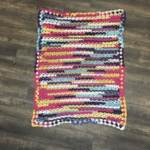 Handmade ceochet childs multicolored blanket