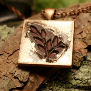 Copper pendant highlighting maroon leaves