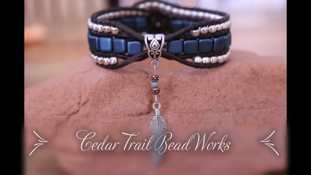 Cedar Trail Bead Works: hand beaded Orchid Aqua with Feather Charm