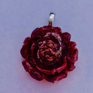 Rose flower with rose gold flakes earrings and pendant