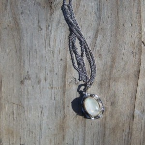 Australian white fire opal doublet set in sterling silver necklace.