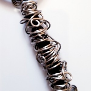 CHAOS - Wrapped Black Lava Stone Beads in Silver Wire Cage Necklace