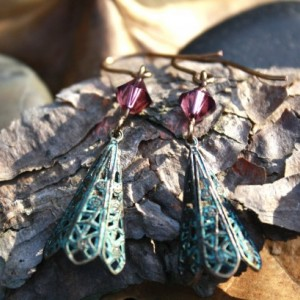 Unique patina earrings accented with purple crystal
