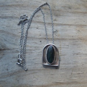 Labradorite cabachon set in a hand crafted sterling silver necklace.