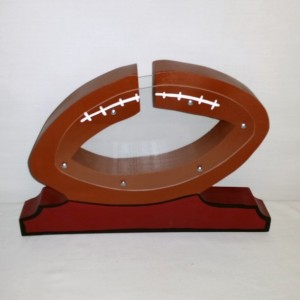 Personalized Wooden Football Money Bank.  The bank size is 8 inches high 12 inches long.