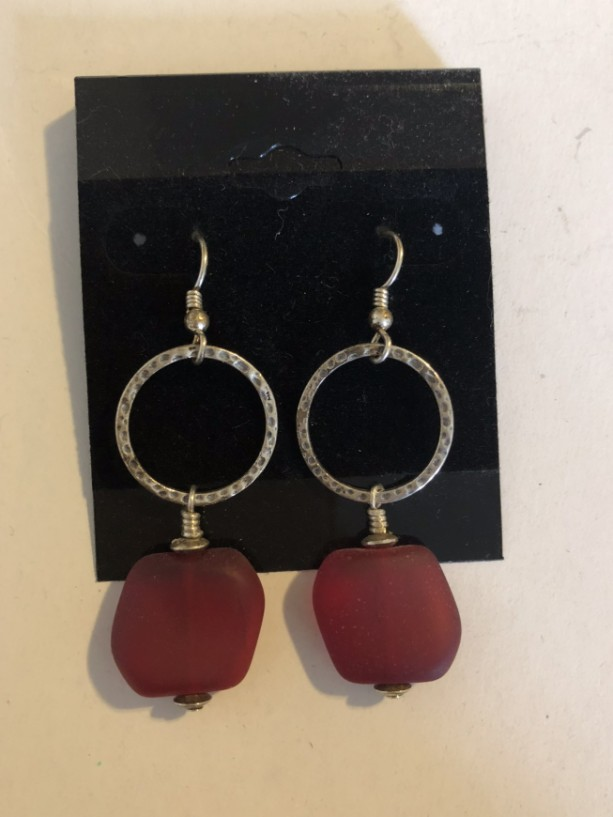 Sterling silver dangle hoop earrings with dark Red Sea glass