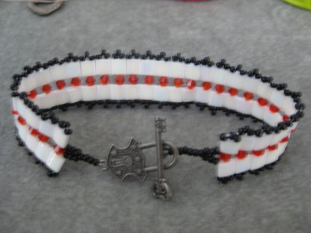 Beaded bracelet Tila beads and Swavorski crystals and black seed beads
