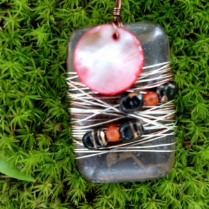 Wire wrapped stone with shell