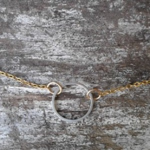 silver on gold karma necklace