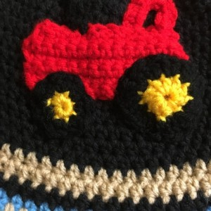 Crochet hat with earflaps/tractor