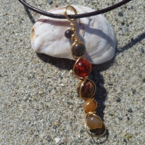 Amber / sunstone / red aventurine wire swirl pendant