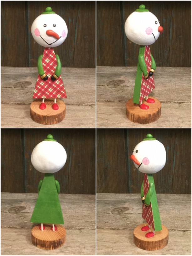 Wood snowman with clay head