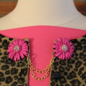 Sweater keeper with pink zinnia flowers and rhinestone centers