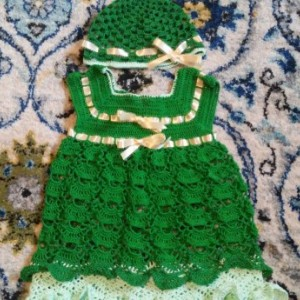 Crocheted baby girl dress and hat set