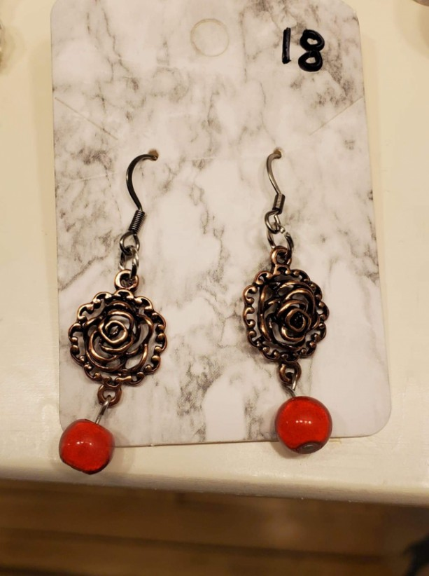 Charm and red bead earrings