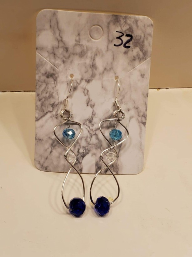 Figure 8 design with blue and clear gem earrings