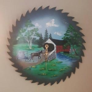 Real saw blade clock. Handpainted clock.