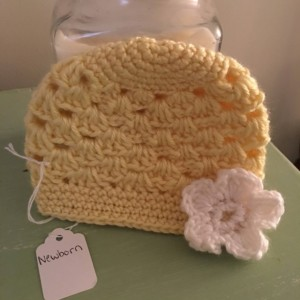 Newborn/preemie yellow beanie with flower