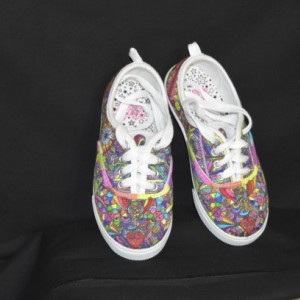 Hand designed and hand painted and colored canvas shoes