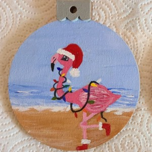 Santa Flamingo walking on the Beach