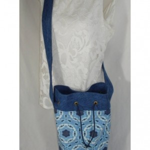 Crossbody TIE DYED BUCKET Bag with large mouth opening and blue denim accents and straps