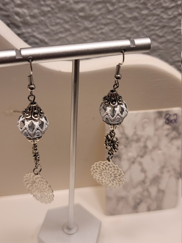 White bead with metal work feature earrings