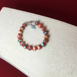 Multi colored orange and aqua beaded bracelet