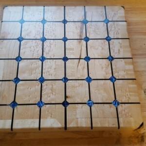 Magnetic tak set made from birdseye maple, gaboon ebony,wenge,and light blue acrylic