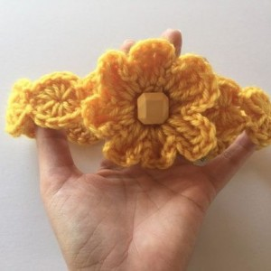 Crochet head band with flower in yellow