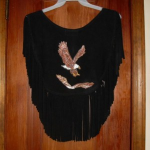 """Black deer skin leather poncho/caplet. 8"""" Fringe Size Medium up to approx large. 16"""" across the shoulders, approx 17"""" long w/fringe"""
