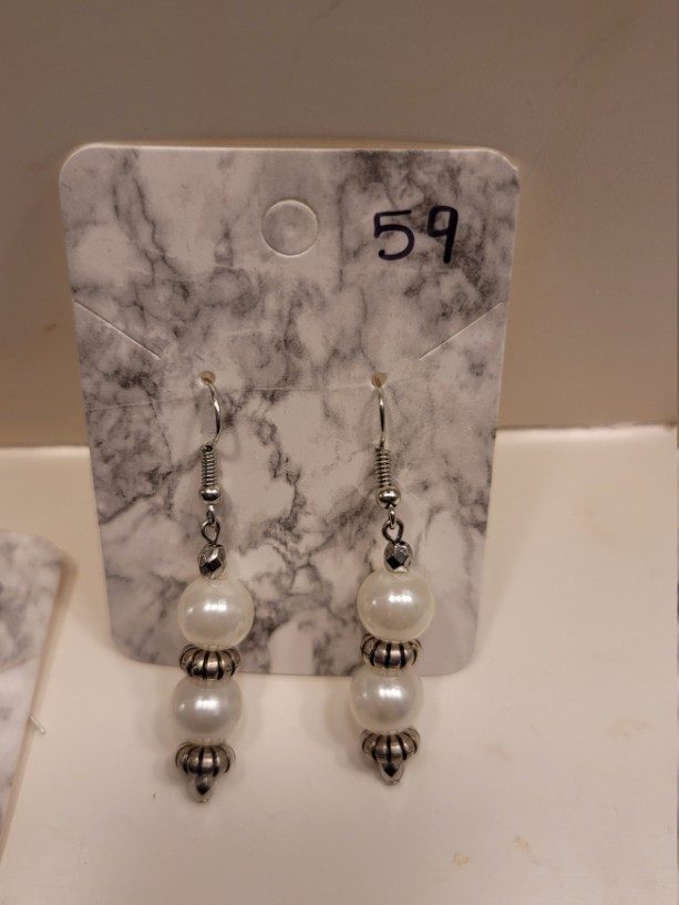 White imitation pearl with silver accent earrings