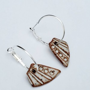 Earthy charms on silver tone hoops