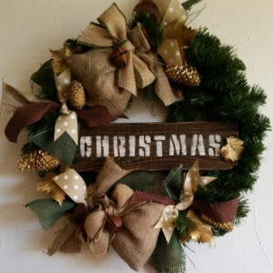 Rustic, handmade Christmas wreath with burlap scent bags