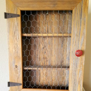 Country Cabinet. Rustic Spice Cabinet with Chicken Wire & Red Distressed Knob. Country Kitchen Cabinet