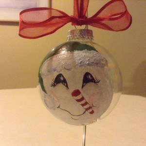 Handpainted snowmen ornaments with beautiful detailed faces and coordinating ribbon hangers.