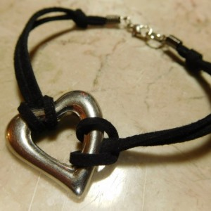 Black Suede/leather bracelet with stainless steel heart connector charm. #B00237