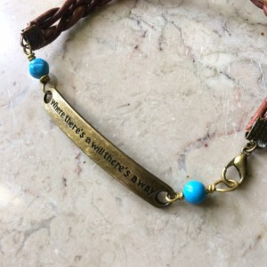 "Brown braided leather bracelet with bronze tone plate connector said ""Where there's a will there's a way""& turquoise beads.# B00245"