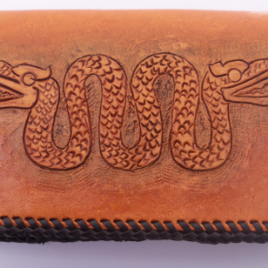 Golden Tan leather checkbook cover, tooled Aztec serpent on cover.