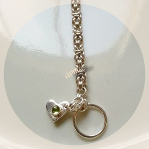 Byzantine weave chain maille sterling silver bracelet with sterling silver toggle closure and a peridot heart  charm