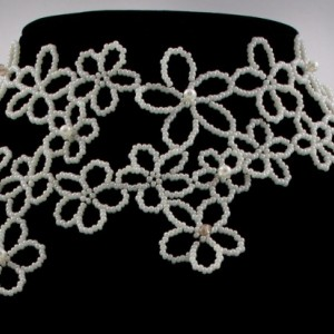 Ivory faux pearl beaded draping flower choker. faux pearl + off white Czech glass beaded draping flower choker. Beaded flower bridal choker